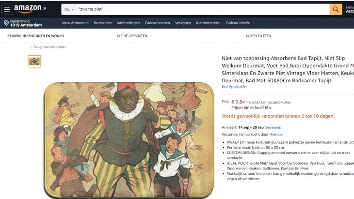Een vloerkleed met een Zwarte Piet van ruim 100 jaar terug; eng en met zak