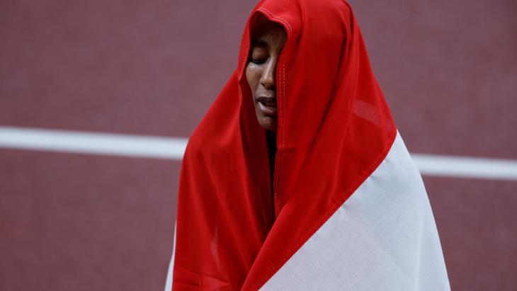 Sifan Hassan in de Nederlandse vlag